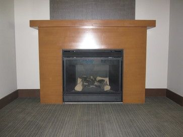 Modern fireplace mantle.  Signature Custom Cabinets Inc.  www.signaturecustomcabinets.com