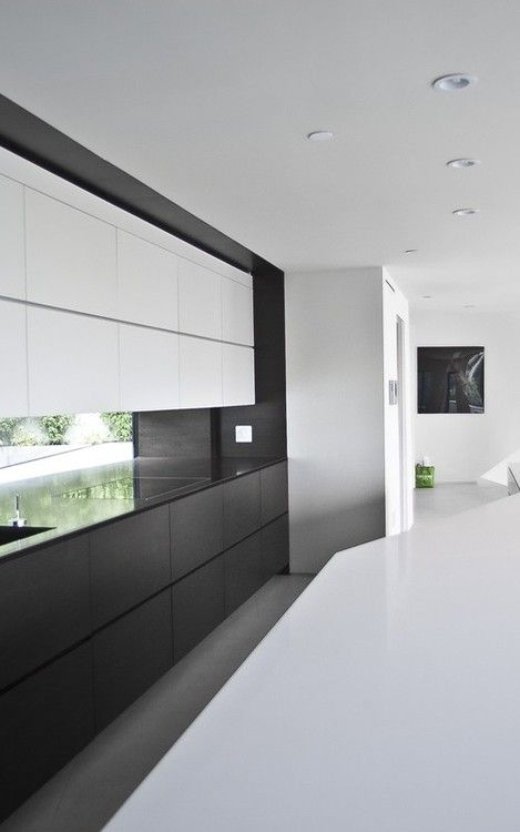 This is exactly what we want with window as back splash ..black and white kitchen