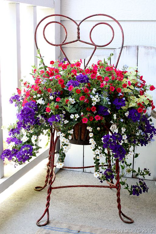 "(""Beautiful pot of course! But I would have to file this under Yard Art because I just love this artsy chair to hold the planter!! Tough choice! Both are really nice!!"")"