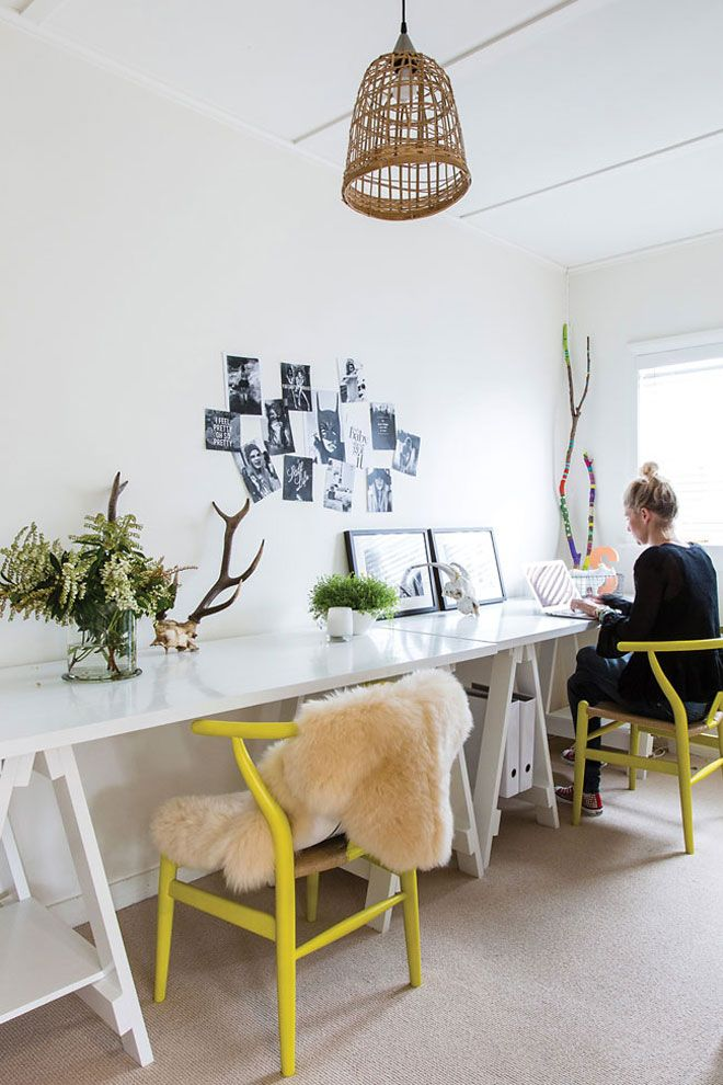 Office with glossy white tables and yellow chairs by Homestyle Magazine