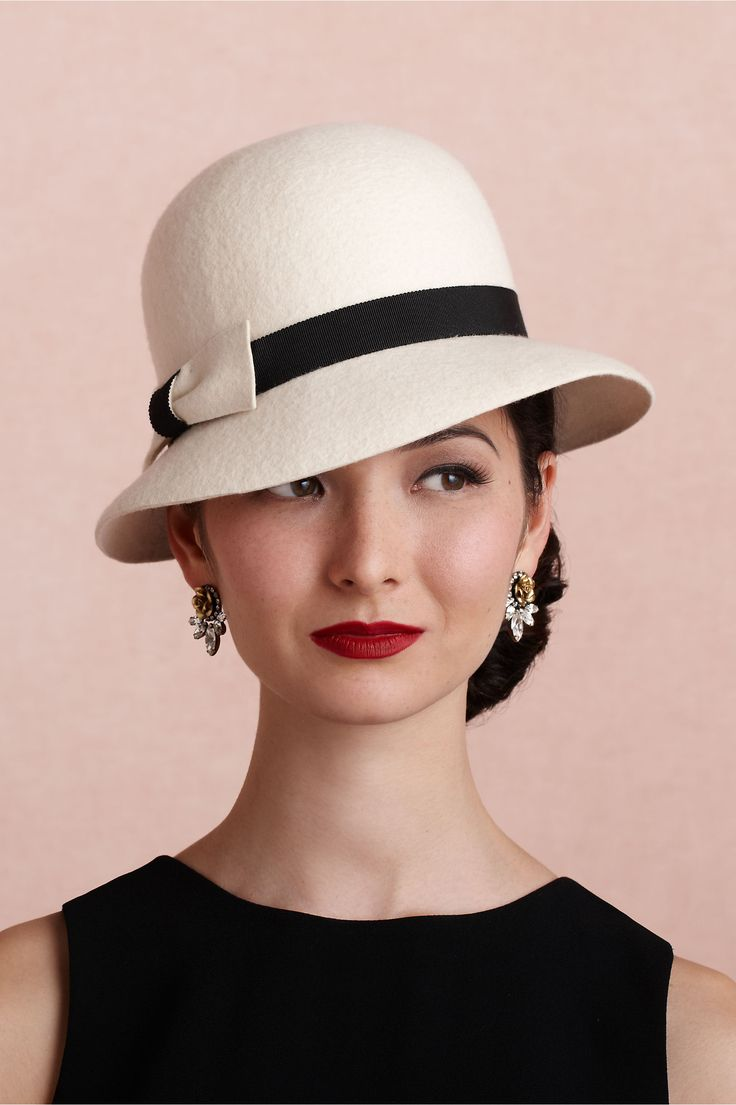 "Cinema Cloche For the lady with a passion for times past, Mademoiselle Slassi's black-and-white chapeau seems plucked straight from the silver screen. 2.5""W brim; 5""L, 1.5""W bow. Wool felt, grosgrain ribbon. Handmade in France."