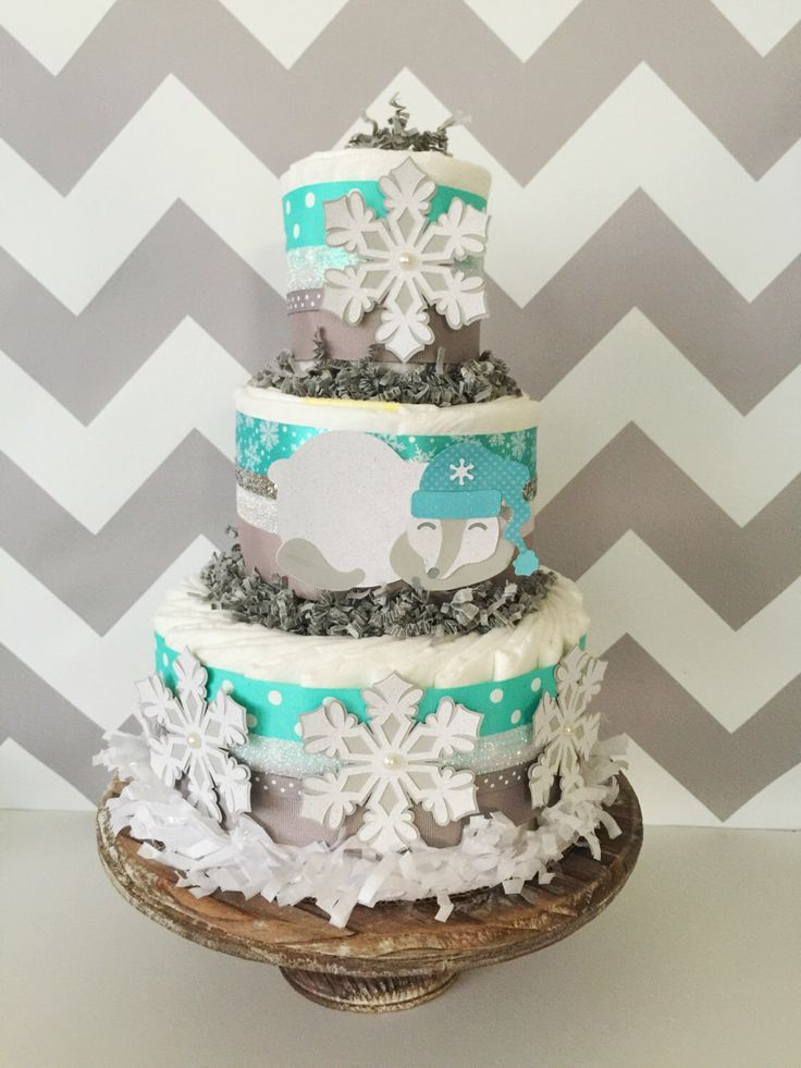 93 best images about winter wonderland baby shower for Baby shower decoration diaper cake
