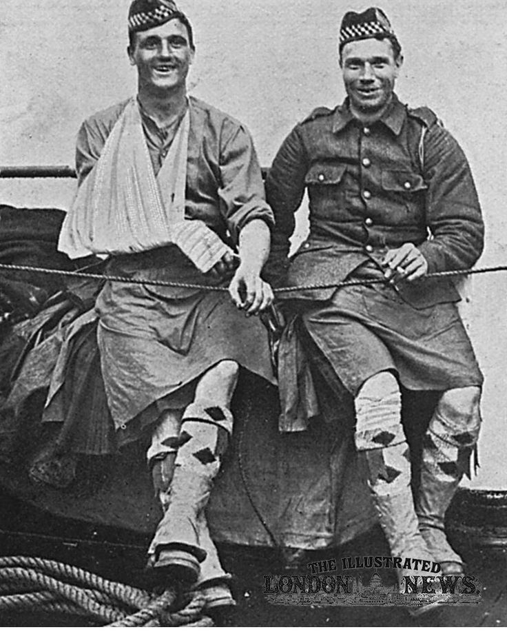 Two wounded, but cheerful, members of the Highland regiment on the Folkestone boat on their way back home from the front line.