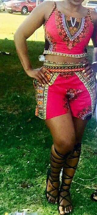This lovely suit is made from a vibrant dashiki fabric. The top is a peplum top and the shorts are straight.  Available in different dashiki