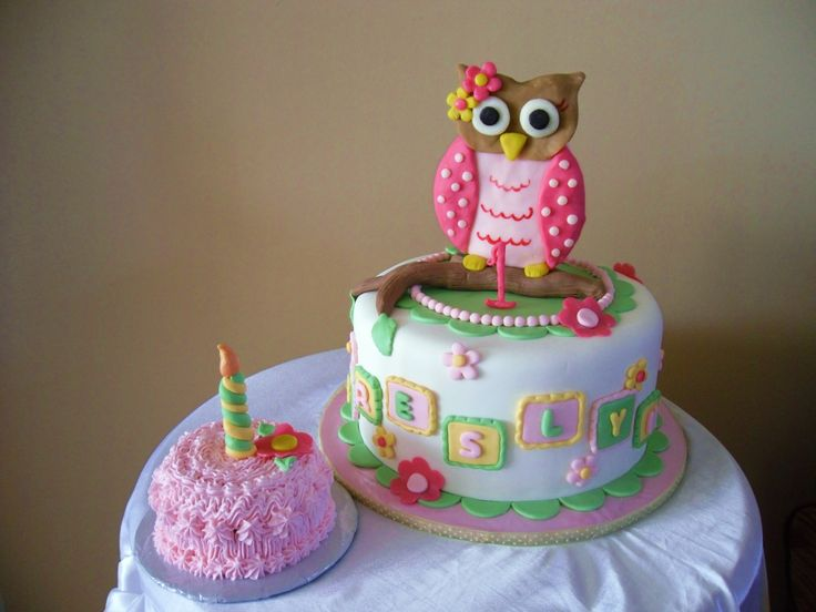 Owl 1st birthday - The mom asked for a girly owl themed cake. I came up with this design after seeing a picture of one of the party decorations she bought. The baby's name (turning one) is BRESLYN