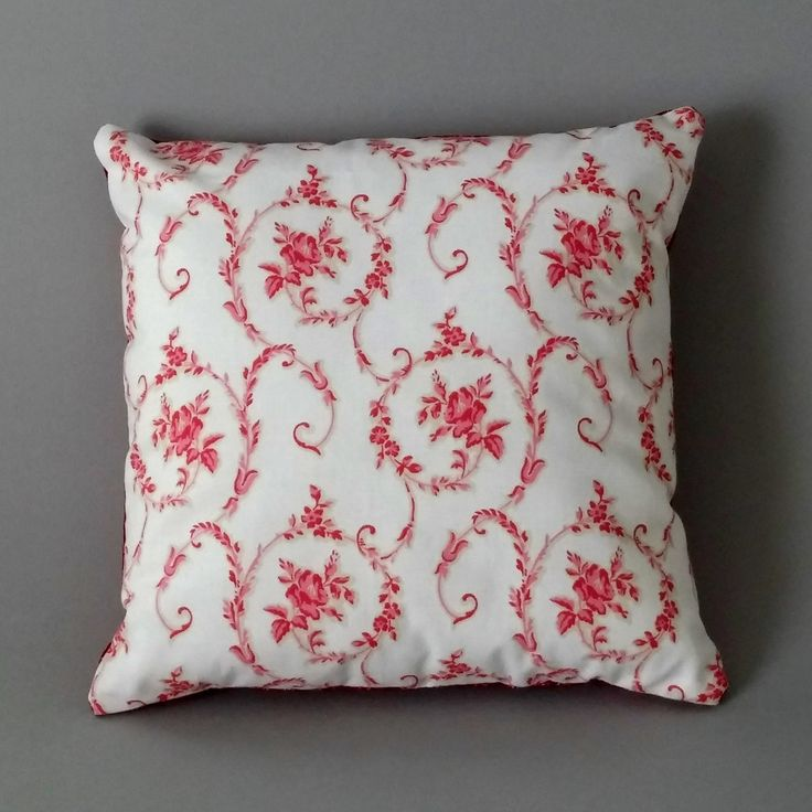Our 'Swirly Cows' cushion combines floral 1990s Laura Ashley fabric with quirky Holy Cows! fabric from Windham Fabrics. Pinks, white, red and cream.
