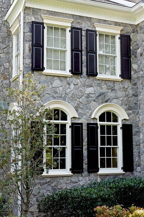 Stone cladding architecture pinterest window casing for Black stone house