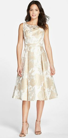 Neutral dress for the mother of the bride | Pretty tea-length dress in champagne and gold with embellished neckline