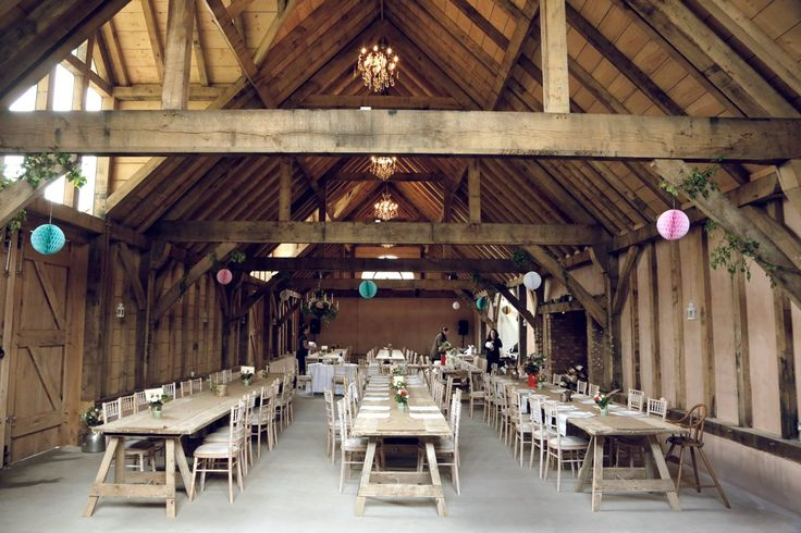 Busses Organic Farm, West Sussex. Our newly constructed real oak barn is the perfect venue for great occasions. With its high ceiling, open rafters, generous beams, grand doorways and huge fireplace, it is truly stunning
