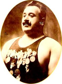 Nectar e Libro: Δημήτρης Τόφαλος . Gold Olympic champion 1906 (weightlifting),  a freestyle wrestling champion in America where he became a legend. 251 wins  in Freestyle wrestling and 140 in weightlifting. Jim Londos' coach.