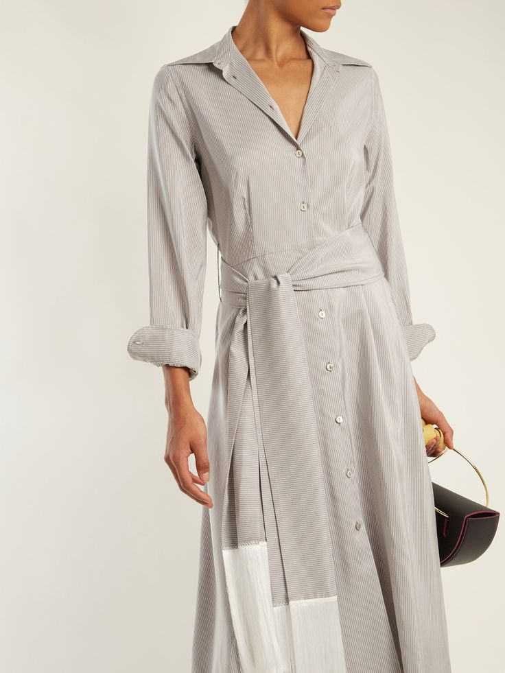 Denoting the classic English tailoring at the heart of Hillier Bartley, this light-grey silk-blend dress has timeless appeal. It's crafted in Italy with a white pinstripe pattern and matching fringe-trimmed belt, which can be tied at the waist to accentuate the flattering cut. A centre button fastening runs from the point collar to the hem, and there's an inverted pleat at the rear. Style it with off-beat leather accessories for a chic interpretation.