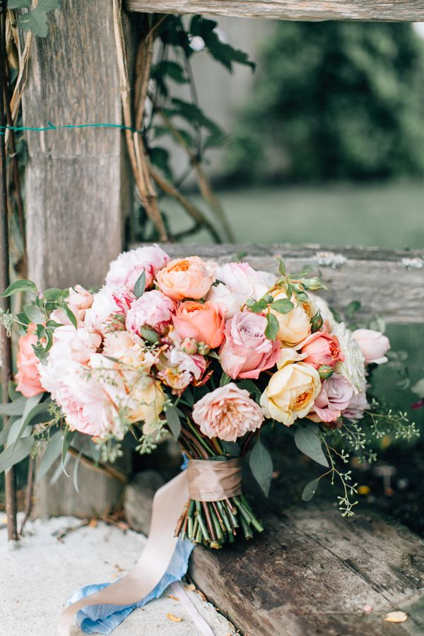 soft pink bouquet - photo by Lora Grady Photography http://ruffledblog.com/fairytale-cottage-wedding-at-craven-farm