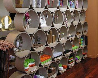 cardboard tube bookcase but also can use as a wall divider. Love it! I would add a mosaic touch inside the tubes and led lights around the the back of the tube. And of course paint the outside. :)