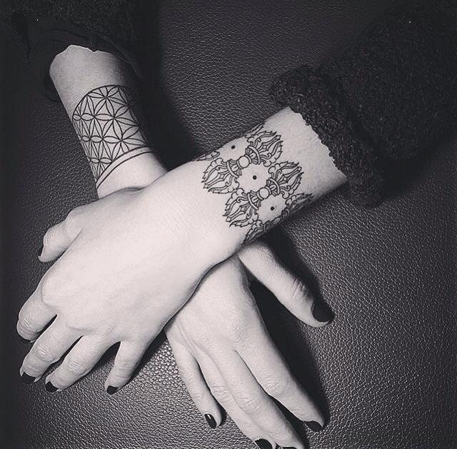 Exquisite wristbands by Sasha Masiuk.