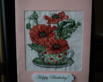 A Poppies pendant  made in Petit point technique by DIANTAstudio