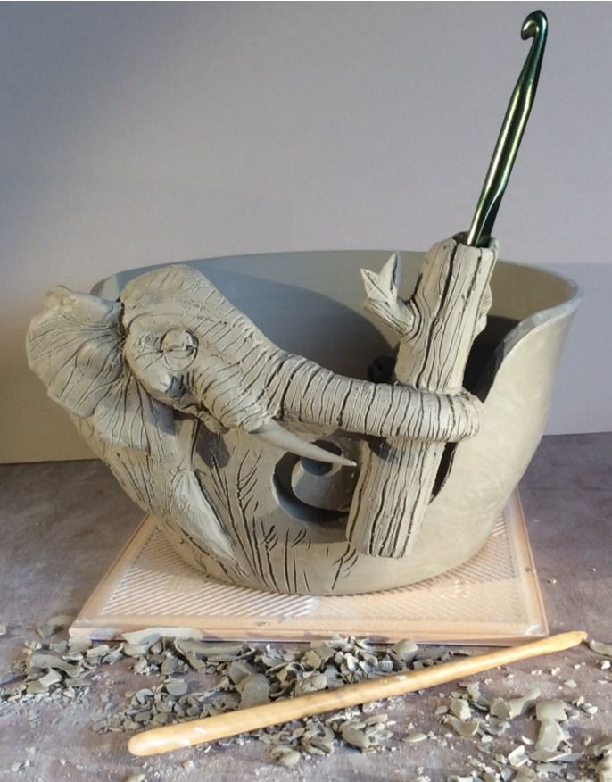 Elephant yarn bowl with hook holder …work in progress. This custom order is almost made with detail and cleaning up the modelling still to do. This design is a variation on the Elephant bowl I have already made where the customer wanted a holder for a crochet hook incorporated into the bowl. Another photo or two to follow as this is underglazed and glazed. earthwoolfire@gmail.com