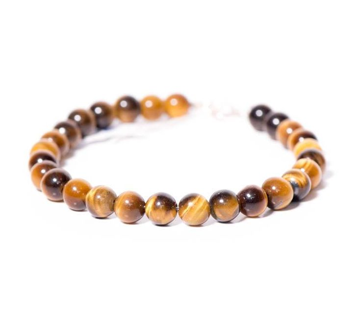 Women's bracelet with Tigers Eye and 925 sterling silver findings by Blue Handmade Jewels.  https://www.facebook.com/BluelJewels/
