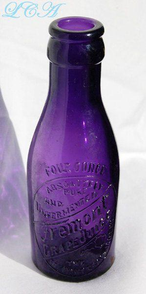 Small antique FREMONT Ohio GRAPE JUICE bottle in a vibrant deep purple amethyst color.