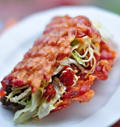 How to: Make a Bacon Taco Shell ~ then fill with taco seasoned beef burger, shredded cheddar & pepper jack cheese, shredded lettuce, fresh pico de gallo and an avocado & cilantro ranch sauce.