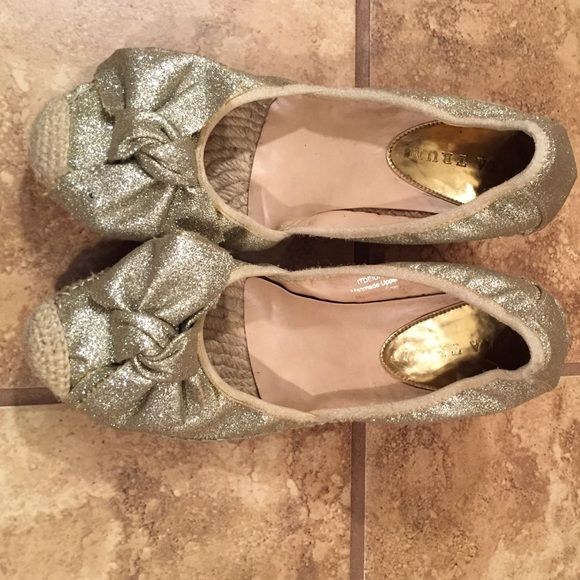"Ivanka Trump Gold Bow Shoes Gold glitter wedges with bow. 3"" wedge heel. Ivanka Trump Shoes Wedges"