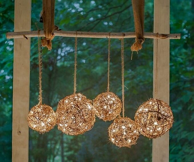 Here is the superb porch project. This DIY outdoor chandelier is so simple to make. You only need Grapevine Balls, 2 sets of white lights, Garden twine, Birch branch and Burlap ribbon. Thread the lights inside the balls, tie them in place with a bit of garden twine and get ready to love the soft glow of these tiny white lights.