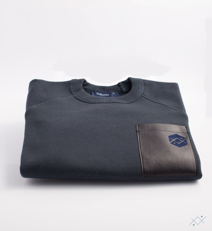 Navy cotton sweat with raglan sleeves. Black Faux leather on chest pocket and on elbows pads.  Ocean Stitch - small details proudly made in Portugal