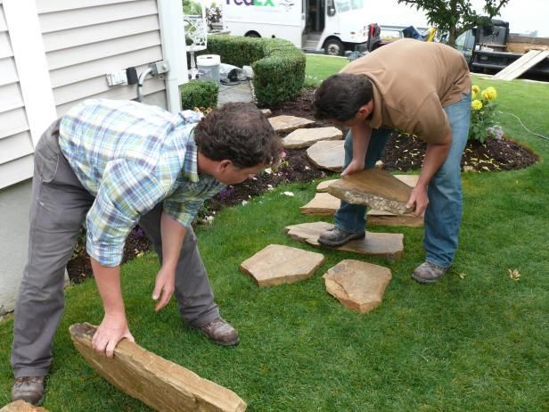 Start by laying the flagstones on top of the grass to check spacing and begin to consider the pattern and look you want to achieve.