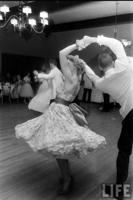 Swing dancing in the 1950s.  I love the swishy crinoline petticoat underneath!