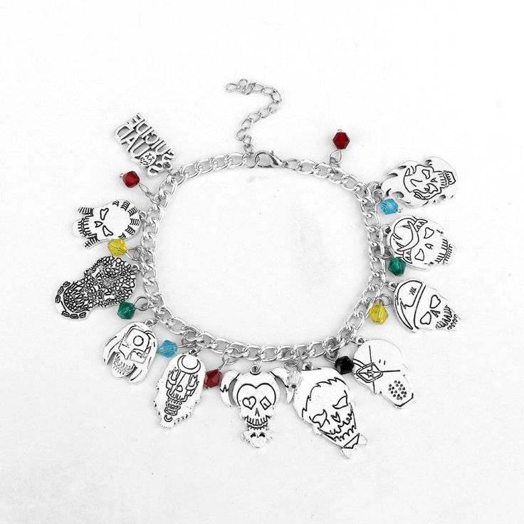 """We just got this cool bracelet in, and knew you would love it. - """"Your friends are gonna be sooo jealous."""" - Features skulls caricatures of the cast of the Suicide Squad set around a alloy link chain."""