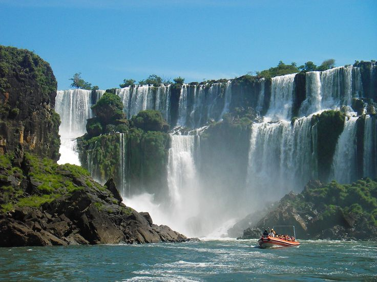 Take a boat tour under The Iguazu falls, in South America, the biggest falls in the world (four times the width of the Niagra Falls).