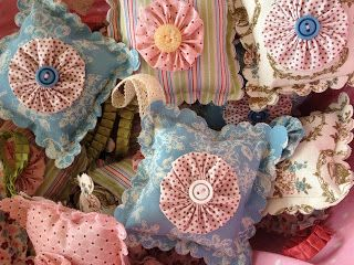 Pretty lavender bags on a scallop square with yo-yos on the front.