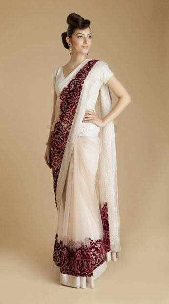 Varun Bahl - Red Velvet Net Sari -   $1,770.00 - White net sari with velvet applique. Handwoven basket weave border with white pearl sequins. Paired with white sequin sheeted blouse. Silk petticoat included.  Additional blouse designs and fabric options are available.  Email orders@couturerani.com for more info.