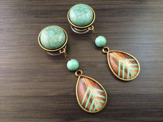 Pair of dangly plugs with beads and teardrops that have a wood cheveron pattern in minty turquoise.    Multiple sizes available in this design.