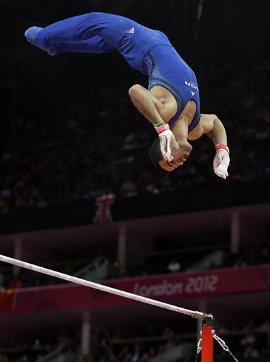Team USA's Danell Leyva competes on the high bar at the London Olympics during the men's gymnastics event finals.