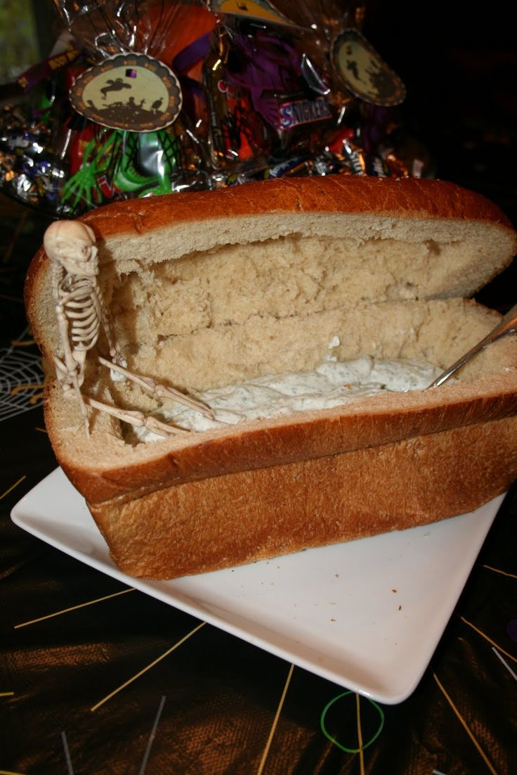 BOO! 23 Creepy, Creative Halloween Party Foods. Bread coffin dip is a cute idea.
