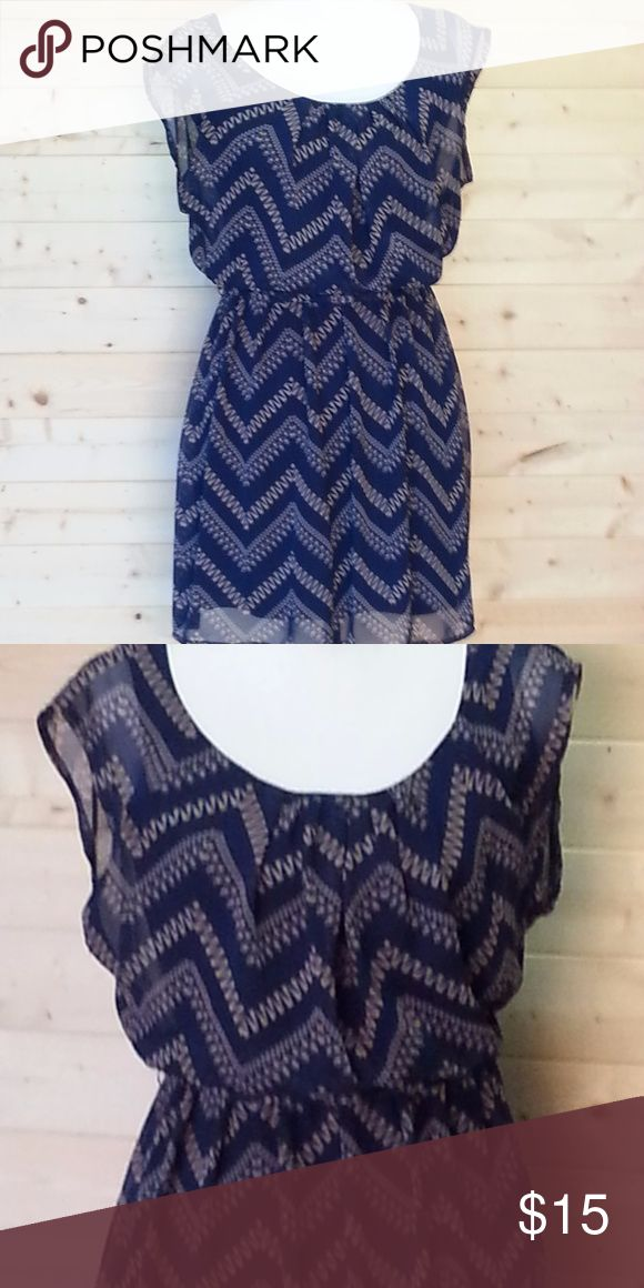 Lily Rose Blue Chevron Dress This cute little dress is a perfect addition to your warm weather wardrobe. It can also be paired with a sweater or jacket for wearing it in cooler weather. Ladies extra small dress with a sheer outer layer. Dark Blue attached camisole dress under sheer layer. This dress is a dark blue color with a tan chevron pattern. Attached belt to cinch in the waist Lily Rose Dresses