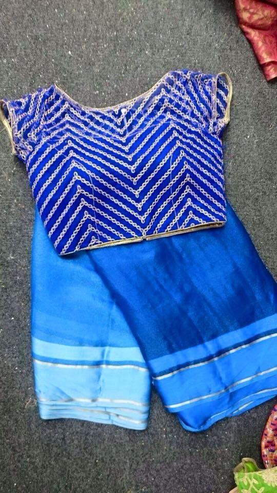 Pretty blue silk saree and statement blouse.