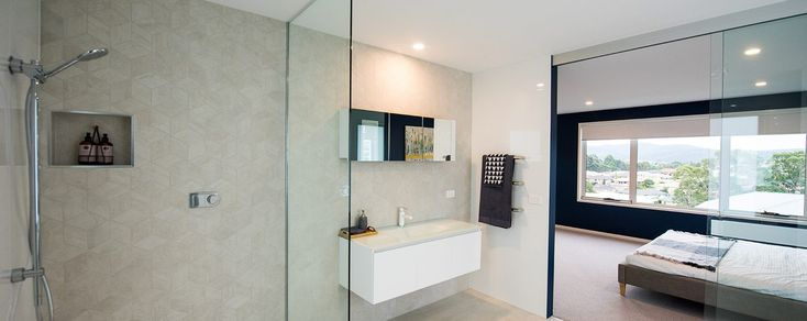 Notice the nifty alcoves and multi-purpose storage spots to hide away all your beauty products in this sumptuous ensuite - Sapphire Home Design - On display at Kingston TAS  #bathroomstorageideas #wilsonhomes