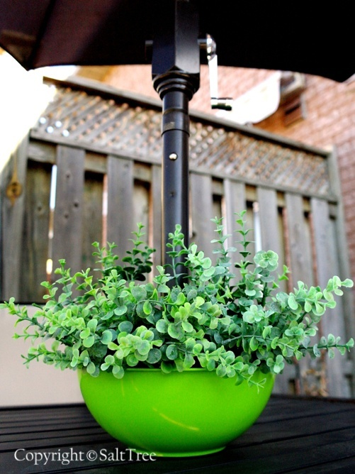 DIY Planter for Umbrella Patio Tables.  I HAVE to share this w/ my mom. Maybe make her one for Mother's day.