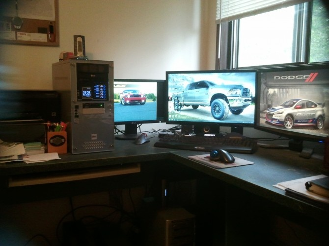 Started with one monitor, then went to two to try it out and could never go back. Then I made enough room for a third and love it. The small monitor is also hooked up to the Media Server along with the 2nd mouse and the keyboard in the tray.  The PC is custom built, from an old case and all new parts.