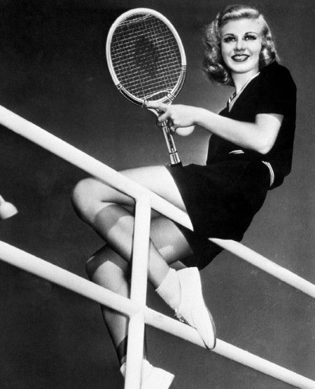 Ginger Rogers looks effortlessly chic in black top and shorts with ankle socks and plimsoles in 1939.