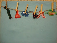 """Retell or sequence """"The Hat"""" by Jan Brett using small clothing with clothespins and a rope or piece of yarn"""