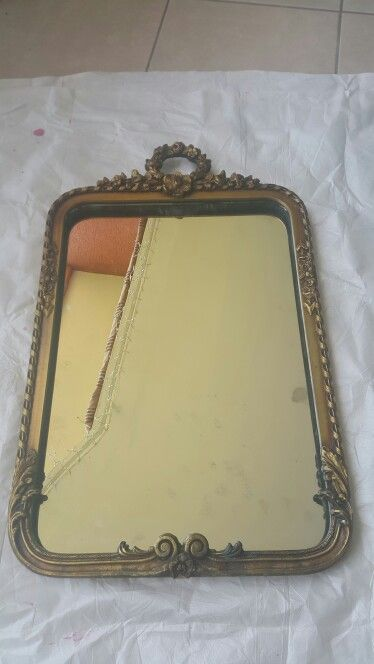 Mirror that hung in my grandmother's foyer then at the mission house in the bathroom before