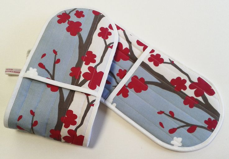 Oven gloves too good to use! We were asked to make a pair of oven gloves to match the roman blinds - the client was so delighted she asked us to make some more.