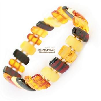 This mixed large pieces bracelet is made from amber stones that have been smoothed so that there are no sharp edges. The bracelets are mounted on double elastic thread and are gorgeous on. Aprrox 18cm in length.While Bambeado amber comes in several colours, the colour is just a matter of personal choice. The colours may vary slightly from the images on the website due to variations in the amber beads. Each amber bracelet is unique.