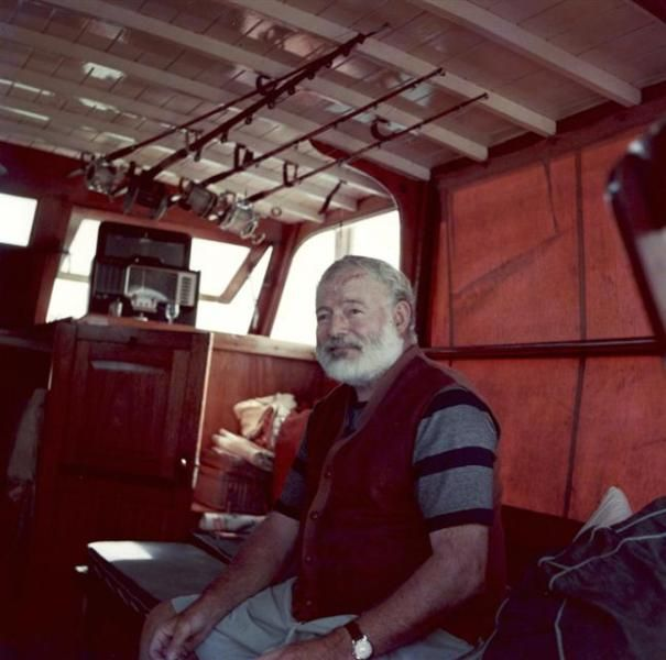 Color photo of Ernest Hemingway aboard his boat Pilar.