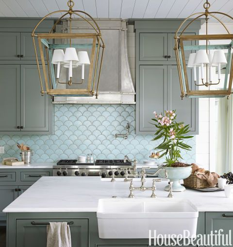 The ocean's shimmery hues inspire a kitchen in Santa Rosa Beach, Florida, by Urban Grace Interiors.