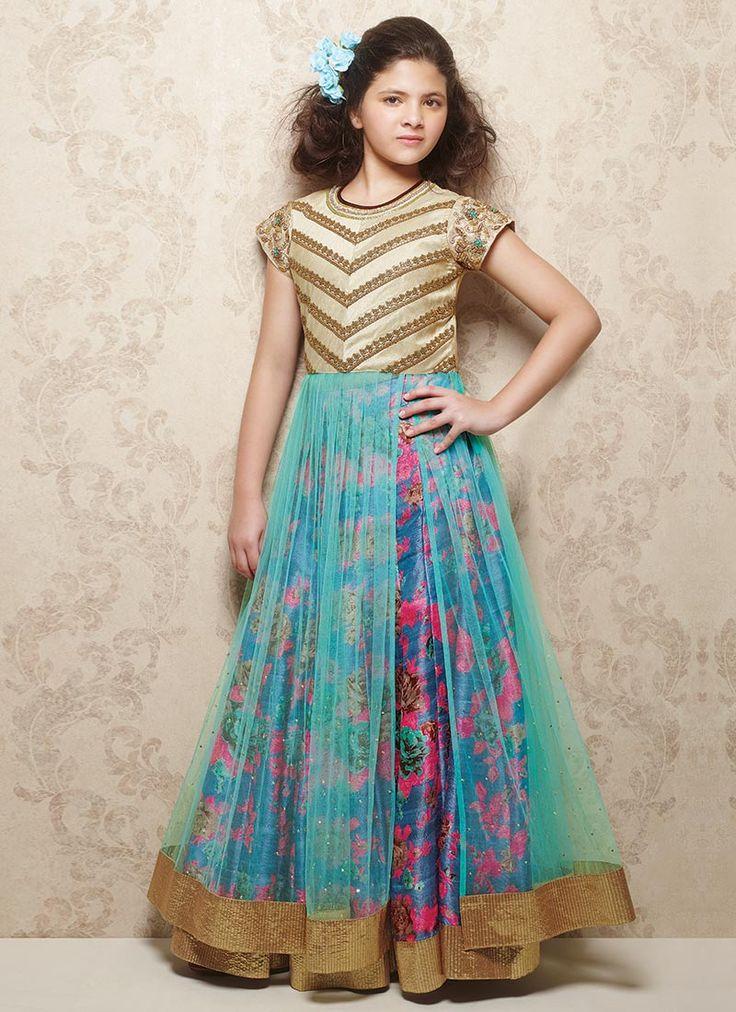 Multicolored net kids long choli lehenga from Doll flaunts embroidered and embellished designed yoke with printed lehenga.