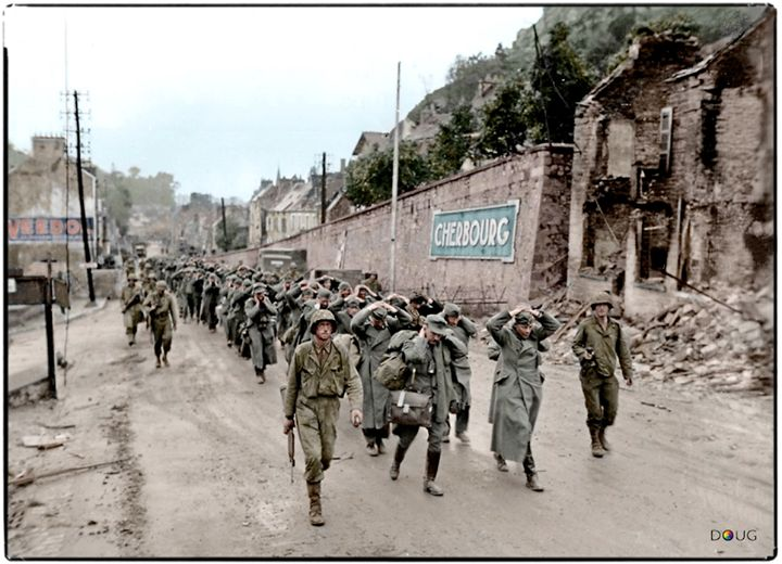 WW2 Colourised Photos US.Captain William H. Hooper, Company Commander L Company, 314th Inf.Regt., 79th Inf.Div. leads a column of German POW's with officers at its head guarded by his men up the Rue Louis Lansonneur, Cherbourg - Paris Road. 26-28th June 1944  Captain Hooper was KIA on the 5th July 1944 some 30 to 40 kms distance away, in the La Haye-du-Puits area.  He was awarded the Purple Heart and is buried in the US Cemetery at Colleville-sur-Mer in Normandy.
