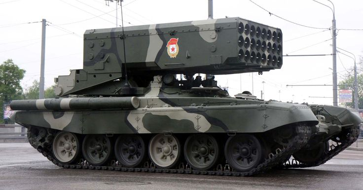 "TOS-1A ""Buratino"" 220 mm Multiple Rocket Launcher (Russia). Very powerful fuel-air explosive rockets. Mounted on T-72 tank chassis. The big brother of the man portable RPO-A. The 1st model with 24 rockets."